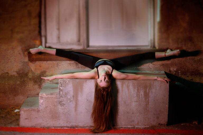 gymnast posing for nigh portraits in McKinney, TX